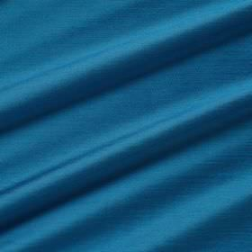 Astor - Voyage - Bright aquamarine coloured 100% polyester fabric arranged in folds