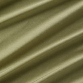 Astor - Pesto - Folds of light leaf green coloured 100% polyester fabric