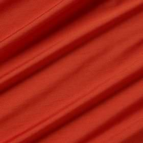 Astor - Holiday - Bright tomato red coloured folds of fabric made entirely from polyester