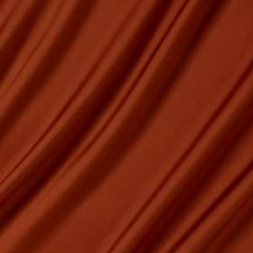 Connaught Silk - Jalapeno - Fabric made from burnt orange coloured silk and wool with no pattern