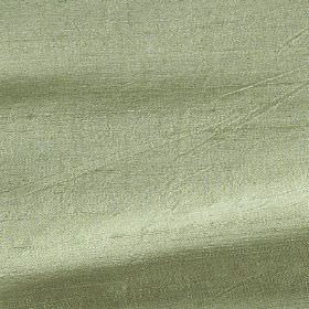 Handwoven Silk - Coriander - Fabric made from light apple green coloured silk with no pattern