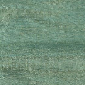 Handwoven Silk - Malachite - Fabric woven from 100% silk in two different shades of green giving a jade impression overall