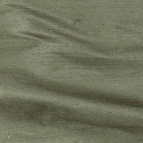 Handwoven Silk - Lichen - Plain leafy green coloured 100% silk fabric which has a very subtle shiny finish to it