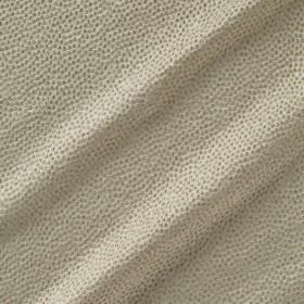 Shagreen Silk - Lentil - Dark grey dimple-like dots covering white fabric made from a blend of polyester, silk, wool and acrylic
