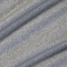 Tesserae Silk - Moonshine - Very subtly patterned blue-grey coloured fabric made from polyester and silk covered with a small snakeskin-like