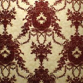 Enchanted - Berry - Very ornate dark red-brown coloured patterns on pale yellow fabric blended from viscose, cotton and polyester