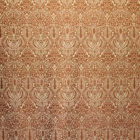 Arabesque - Amber - Fine detail on a dark orange intricate pattern on cream coloured fabric blended from viscose, cotton and polyester