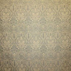 Arabesque - Blue - Repeated, detailed light blue patterns on a pale yellow-cream fabric background made from viscose, cotton and polyester