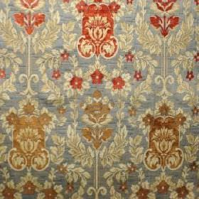 Constance - Verona Blue - Polyacrylic, viscose and polyester blend fabric with a busy, ornate, repeated pattern in blue-grey, red, cream and
