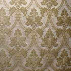 Canterbury - Almond Blossom - A repeated dark green-gold pattern on a silver coloured polyacrylic, polyester and cotton blend fabric backgro