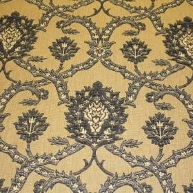 Eliot - Granite - An ornate grey and cream coloured pattern on a light yellow viscose, polyacrylic and modacrylic blend fabric background
