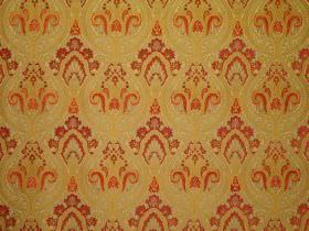 Persia - Apple Red - Ornate burgundy and bright orange patterns on dark gold-green coloured fabric blended from viscose and polyester