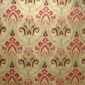 Persia - Cranberry - A repeated, detailed, ornate pattern in pink-red, dark purple and cream-green on fabric made from viscose and polyester