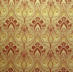 Persia - Spice - A combination of viscose and polyester blended into bright yellow and dark red coloured, ornately patterned fabric