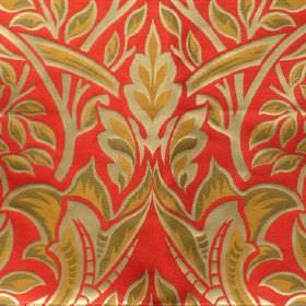 Perla - Dante - Green and orange shading on a metallic gold design of leaves and twigs on coral viscose and polyester blend fabric