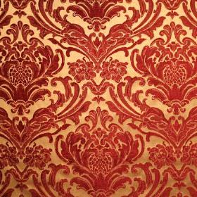 Sheridan - Berry Red - An ornate leafy pattern in crimson, on a light yellow-gold coloured viscose and polyester blend fabric background