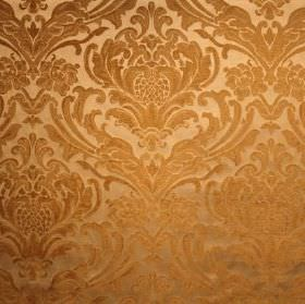 Sheridan - Gold - Viscose and polyester blend fabric with a repeated, ornate leafy pattern in two different dark shades of gold