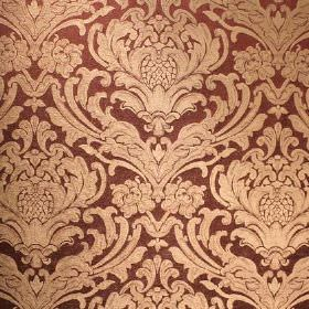 Sheridan - Mulberry - A light cream pattern which is ornate and leafy on a background of dark brown coloured viscose and polyester blend fabri