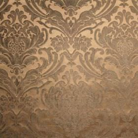 Sheridan - Slate - Cream-gold viscose and polyester blend fabric behind an ornate, leafy pattern in grey-beige