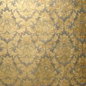 Venice Imogen - Cornflower Blue - A detailed, repeated gold pattern on a dark grey polyester and polyacrylic blended fabric background