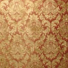 Venice Imogen - Coral - Dusky red fabric made with a polyester and polyacrylic blend and a detailed, repeated pattern in gold