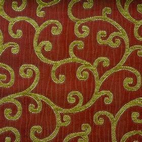 Bronte Charlotte - Terracotta - Lime green coloured swirls on a terracotta coloured polyester and acrylic blend fabric background
