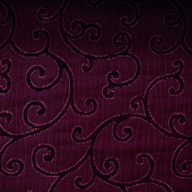 Bronte Charlotte - Burgundy - Fabric containing polyester and acrylic with a simple swirled design in rich, deep, opulent shades of dark bur