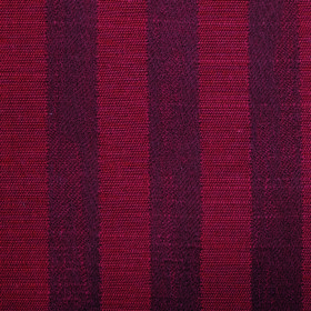Darcey Stripe - Ruby - Aternating bands of scarlet and an even deeper shade of red running down fabric made from cotton and polyester