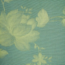 Darcey Leaf - Slate - Fabric made from cotton and polyester in a light shade of dusky blue with a floral design shaded in pale green and cre