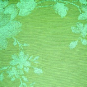 Darcey Leaf - Teal - Light green and blue coloured cotton and polyester blended into a fabric with a floral print design