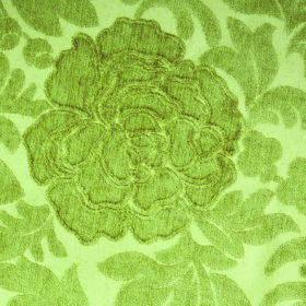 Intermezzo Allegro - Verde - Fabric made from polyester and viscose in two shades of apple green with a pattern of leaves and textured flowe