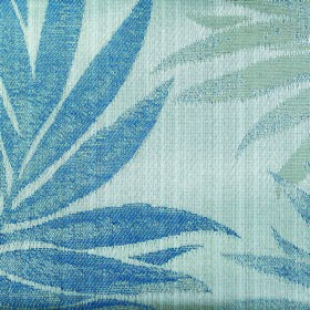 Rufford Fern - Blue - Polyester and cotton blend fabric patterned with patchily printed large leaves in various different shades of blue