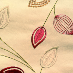 Serenity Leaf - Jewel - Shiny red, gold, green and cream leaves embroidered on a background of 100% polyester fabric in a light caramel colo