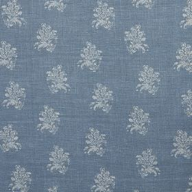 Agnes - Blue - Denim blue coloured linen fabric printed with a repeated pattern of small floral designs in light blue