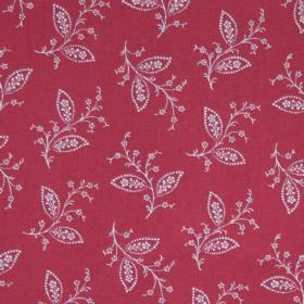 Thelma - Red - Delicate white leaves, stems and blossoms scattered over fabric made from 100% cotton in red