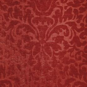 Banbury - Russet - A large, ornate, textured pattern made in brick red on fabric with a mixed filement and chenille polyester content