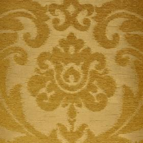 Ashley - Yellow - Light brown coloured fabric blended from three different materials behind large, ornate, leafy designs in gold