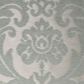 Ashley - Grey - Ornate leafy designs which are large, patterning fabric blended from three materials in two similar shades of light blue