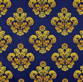 Victoria - Blue Yellow (1) - Bright Royal blue coloured 100% cotton fabric behind a repeated pattern of leafy crest-like designs in metallic