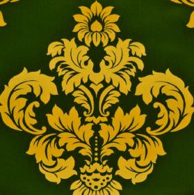 Victoria - Green Yellow - A background of forest green coloured 100% cotton fabric behind an ornate, leafy, crest-like design in shades of y