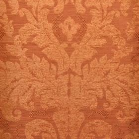 Augusta - Orange - Pinkish copper coloured fabric blended from different materials behind large, ornate, leafy designs in light copper