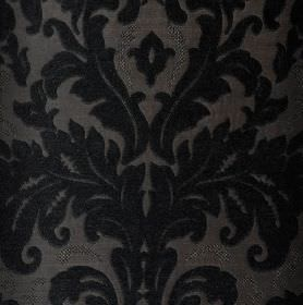 Augusta - Black - A large, ornate, leafy design in slate grey on a background of fabric made from a blend of different materials in grey