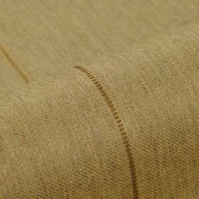 Odeon - Brown (7) - Fabric made from light brown coloured polyester and viscose behind widely spaced lines in gold
