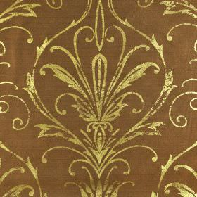 Constanza - Brown Gold (2) - Light brown fabric made from 100% polyester behind a swirling line design in a light, metallic gold colour