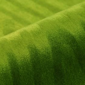 Palora CS - Green - Apple green coloured 100% Trevira CS fabric featuring a very subtle uneven line pattern