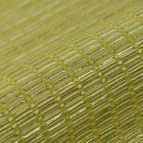 Terbium - Green (9) - Various materials blended together into a cream and silver coloured, slightly raised fabric with a small rectangle patte