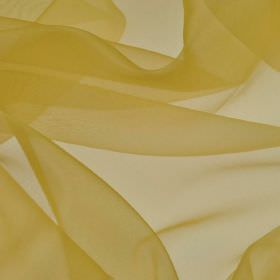 Gavotte - Gold Yellow (9) - Pale golden yellow coloured slightly translucent 100% Trevira CS fabric