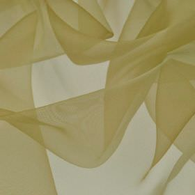 Gavotte - Green Yellow (38) - Slightly translucent fabric made from 100% Trevira CS in a light cream-beige colour