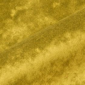 Moresco - Gold Yellow - Warm gold coloured 100% Trevira CS fabric finished with a slightly patchy, textured effect
