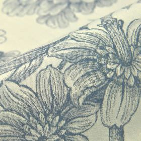 Bourdelle - Cream Blue (7) - 100% cotton fabric in a very pale shade of grey behind a denim blue coloured pattern of realistic shaded floral
